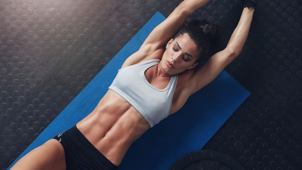 most effective exercise for women's stomachs, a woman with abs