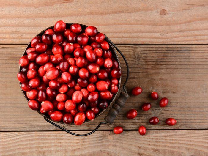 prevent UTIs, a bowl of cranberries