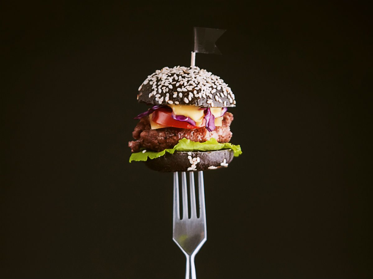 strict diet fail: a burger on a fork