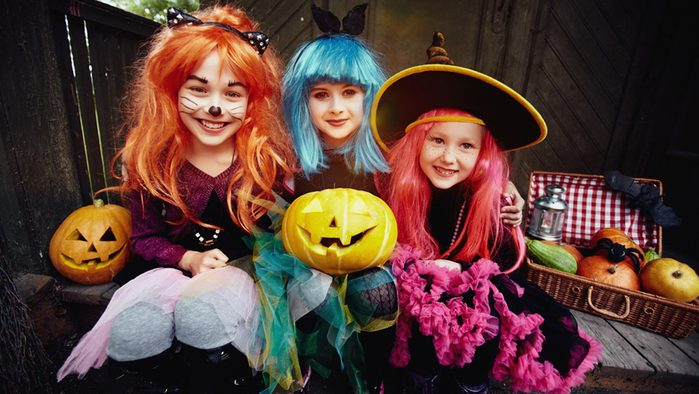 Halloween, three young girls dressed up for Halloween
