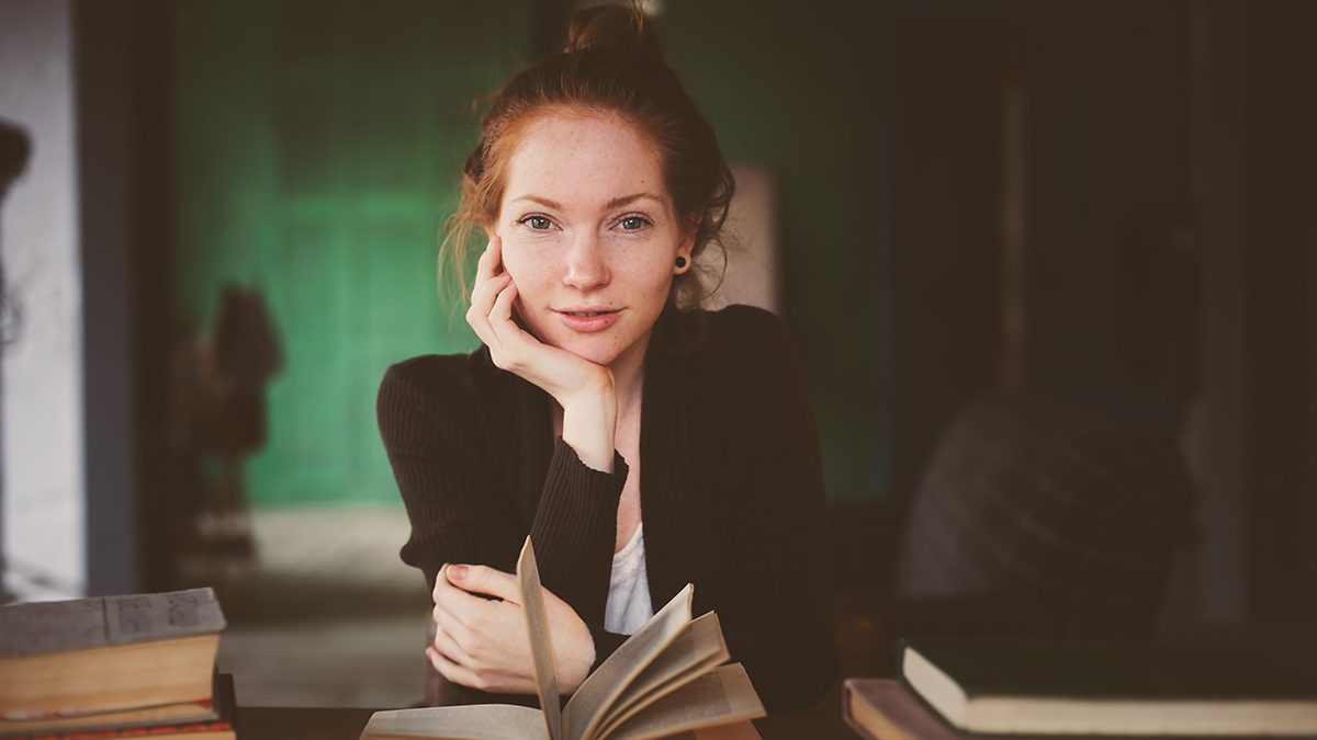calm down now and get help, woman reading health books