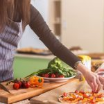 healthy cooking classes in Canada, woman making a veggies pizza