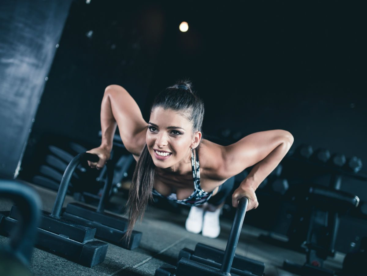 stop hating exercise, woman half-smiling in a push-up