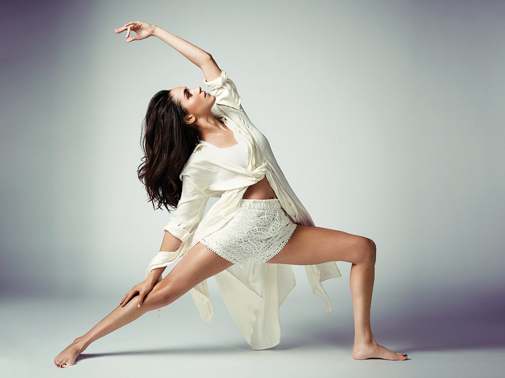 Meghan Markle photos yoga reverse warrior pose