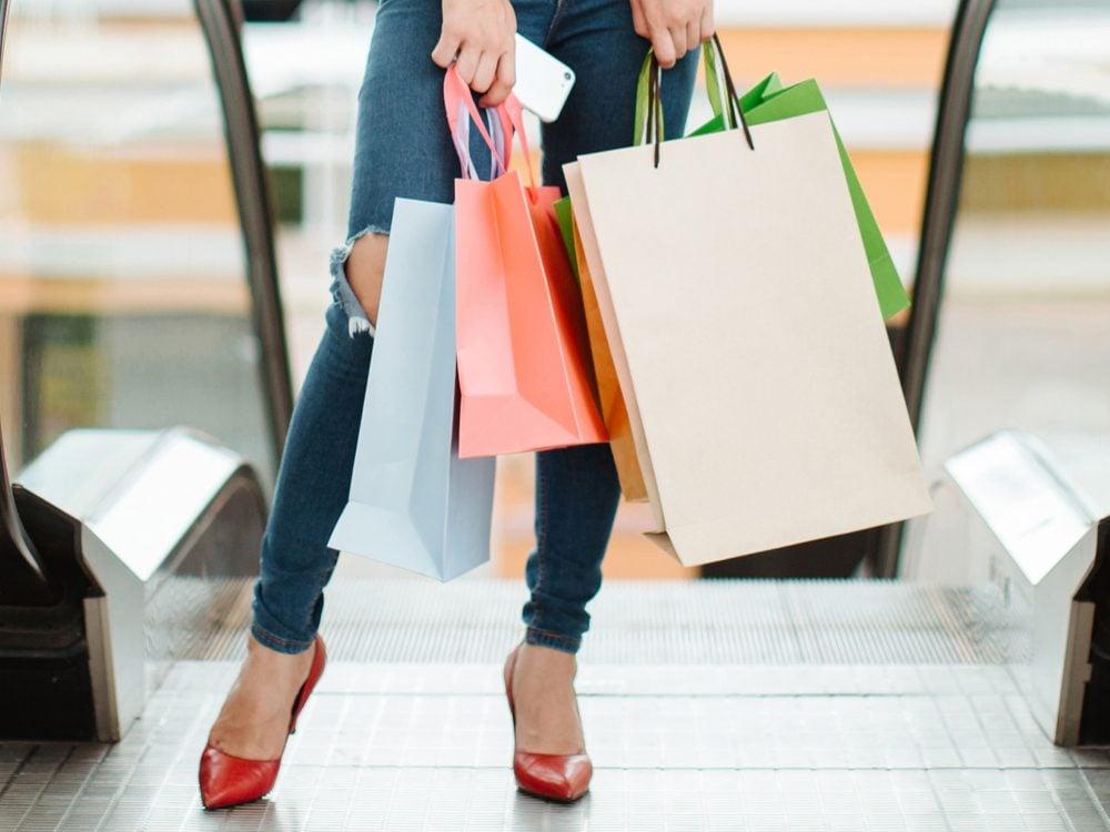 walk more avoid escalators, woman in a mall in front of escalators