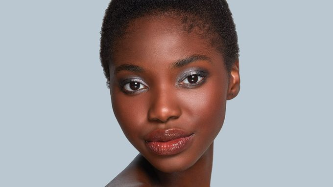 Metallic eyeshadow, woman wearing metallic eyeshadow for dark skin