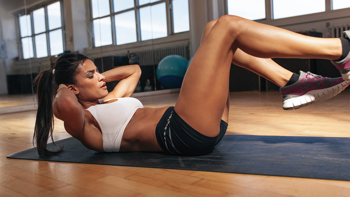 how to get abs, woman inhaling during crunches