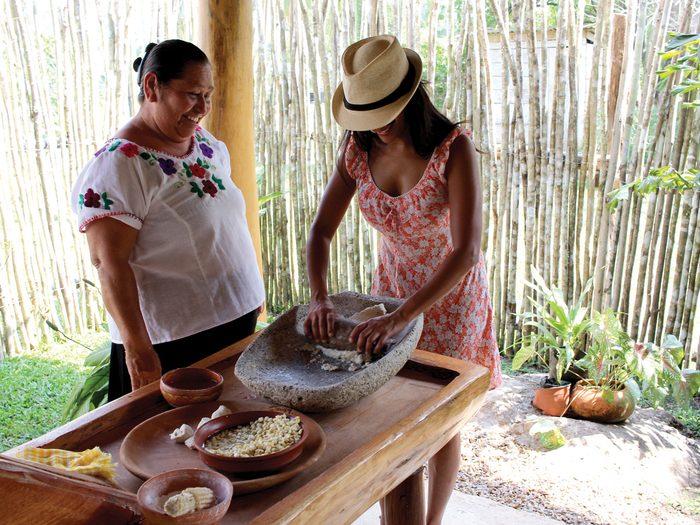 Belize Women co-op, two women doing pottery
