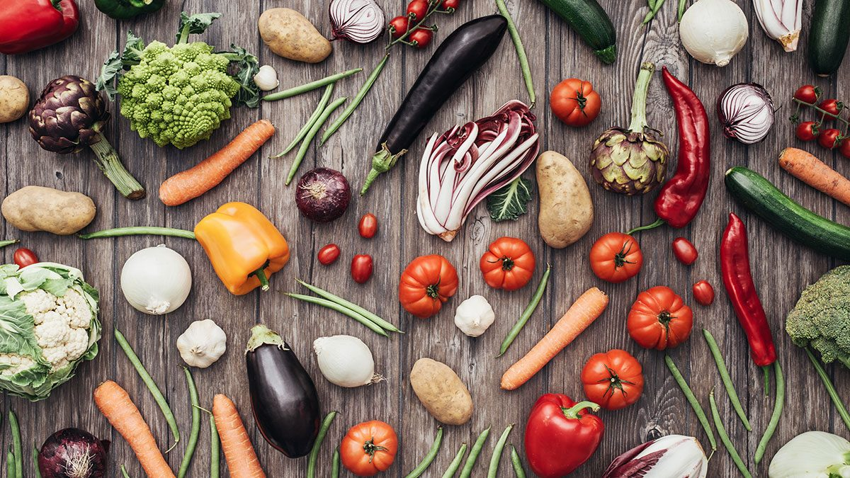 Lose weight, vegetables spread on table