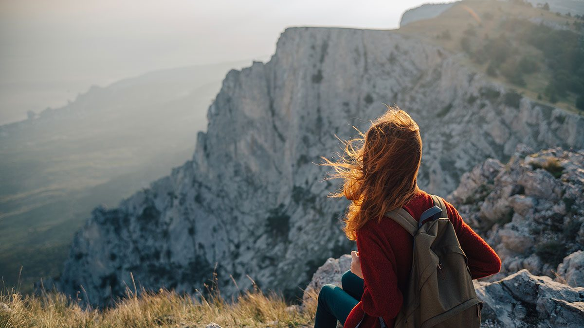 Resolutions, woman on a mountain