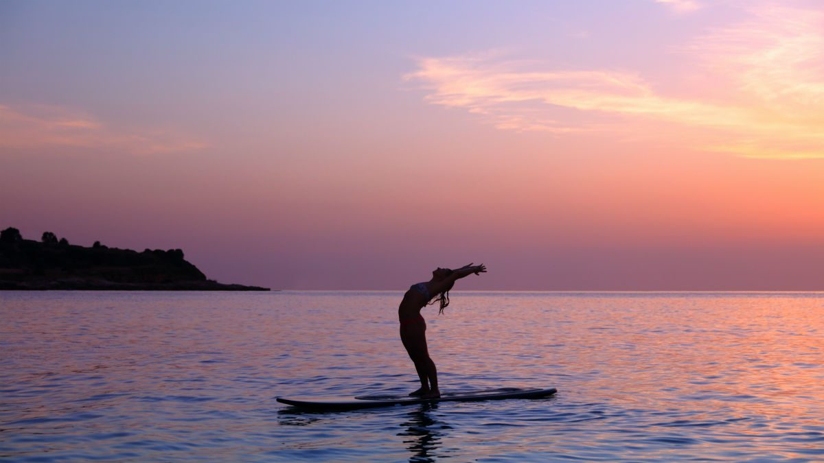 SUP yoga paddleboarding and yoga