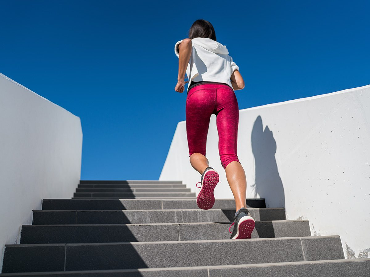 Aging, woman running up stairs