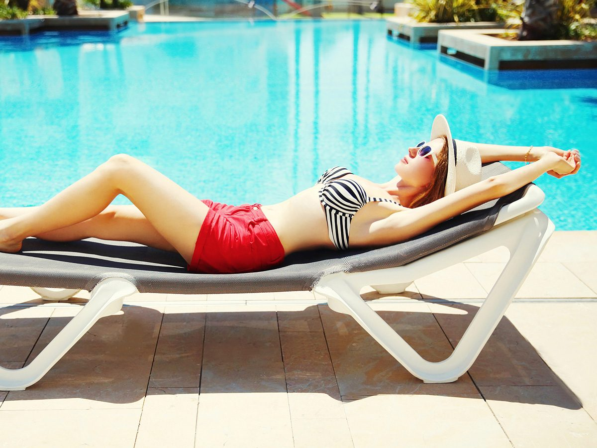 Aging, woman suntanning in bathing suit