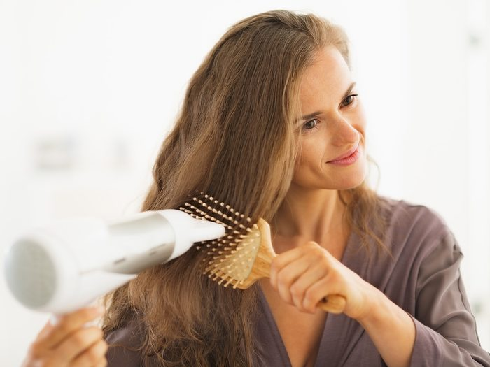 Blowout, woman blow drying her hair