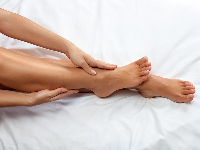 Cold weather, woman touches her very smooth bare legs.