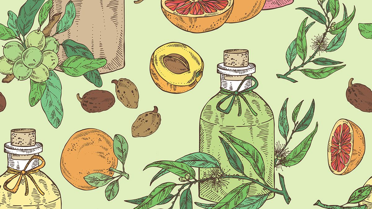 Essential Oils, a couple of bottles and fruit