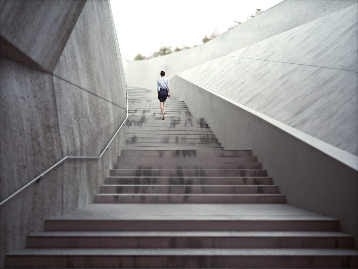 Flat stomach, woman climbing long flight of concrete steps