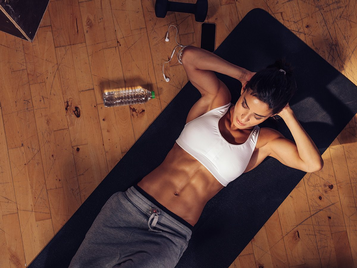 Flat stomach, Young woman with abs doing crunches