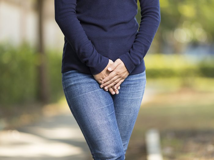 Green tea, woman with UTI holds hands infront of crotch