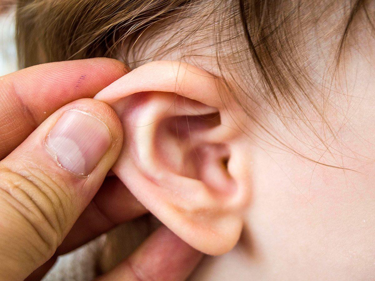 Health myth, A man checks a kid's ear for infection