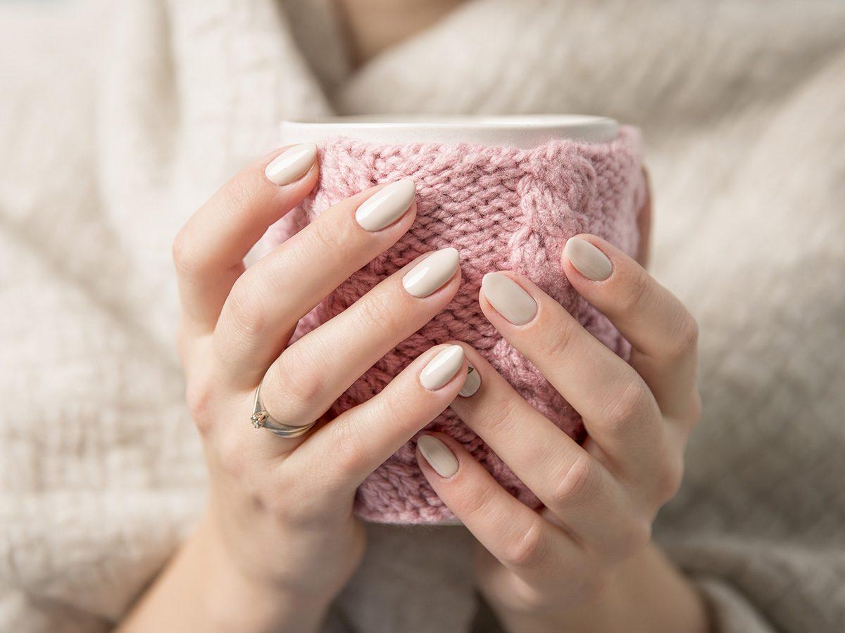 Health myth, A woman with pretty pink nails holds a coffee mug