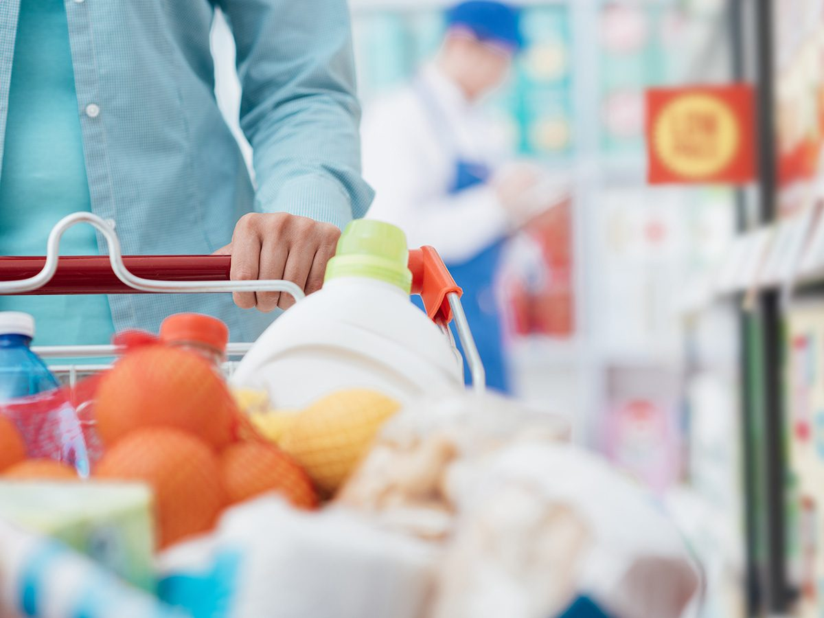 Healthy eating, Closeup of full grocery cart as woman shops at grocery store