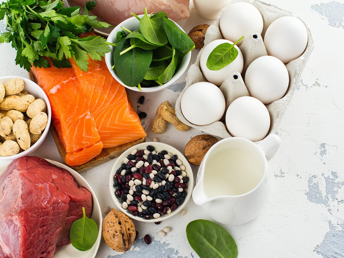 Healthy eating, Counter covered with raw salmon, raw beef, eggs, nuts and other types of protein