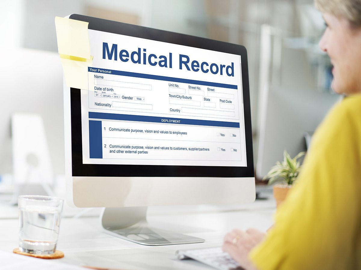 High cholesterol, Woman filling out her medical history on a computer