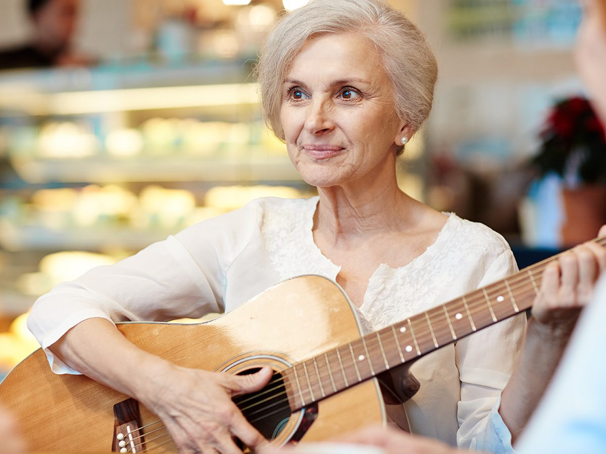 How to improve memory, Elderly woman plays guitar