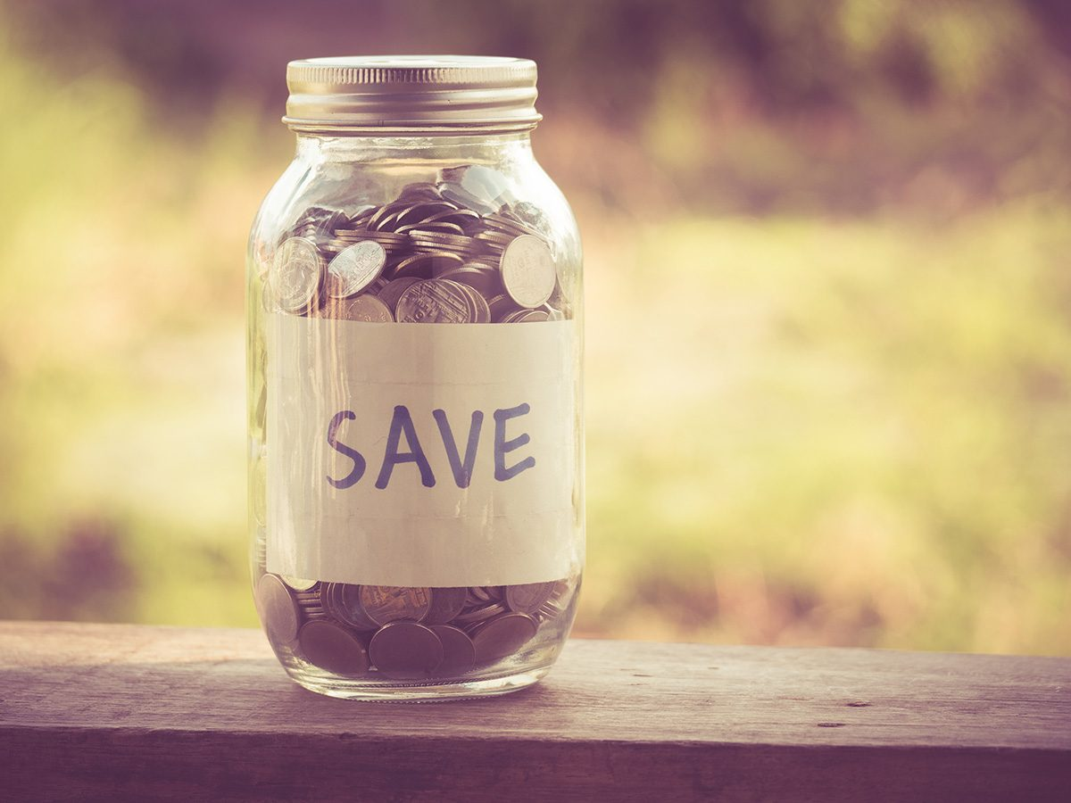 Investing, a jar of coins with the word Save written across