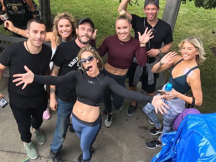 Jillian Michaels standing with a group of people before working out