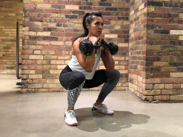 Kettlebell workout, dual kettlebells squat
