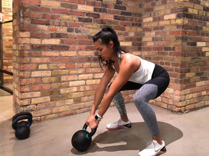 Kettlebell workout, dead swings in gym