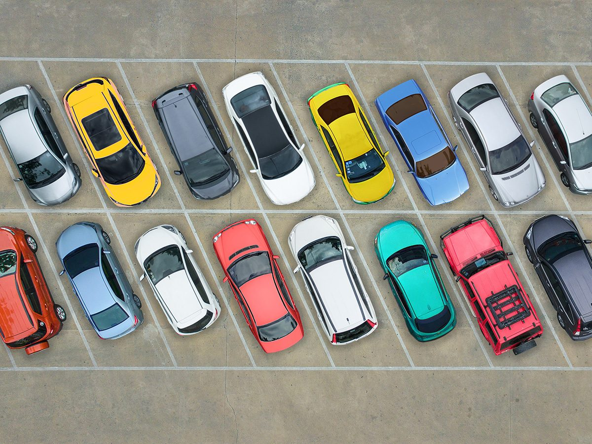 Memory test, aerial shot of colourful cars parked in parking lot