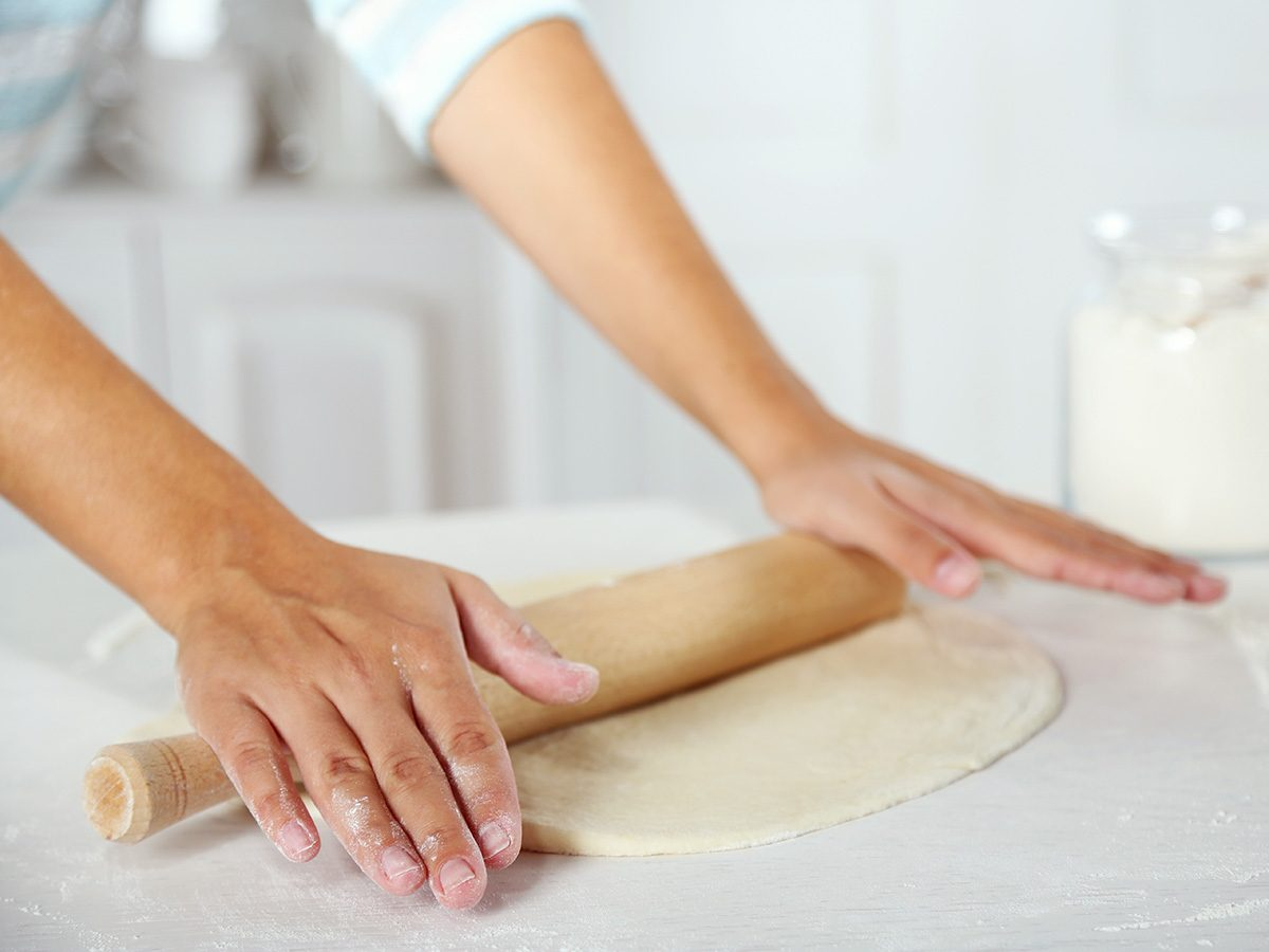 Memory test, Woman rolling out pie dough on counter
