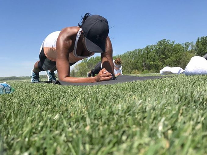 Michelle Obama does a plank outdoors