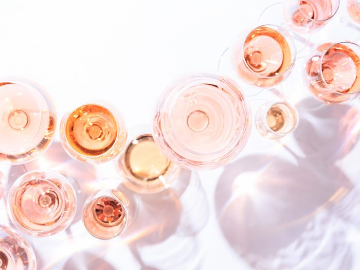 Many glasses of pink natural wine