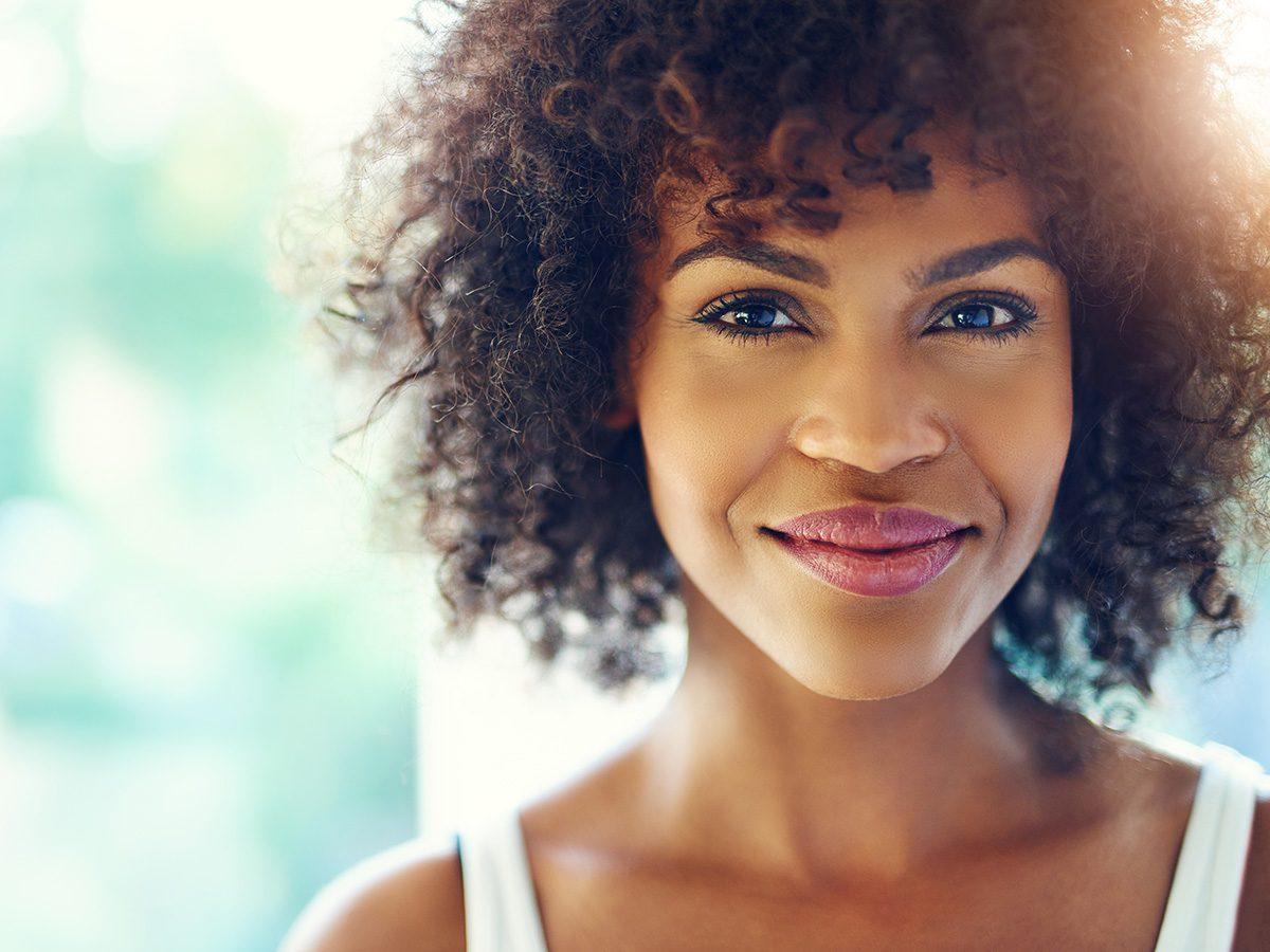 Rainy mood, beautiful black woman smiling