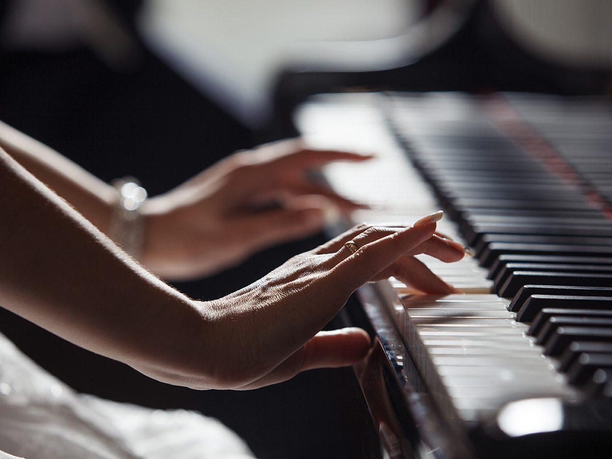 Rainy mood, woman's hands playing piano