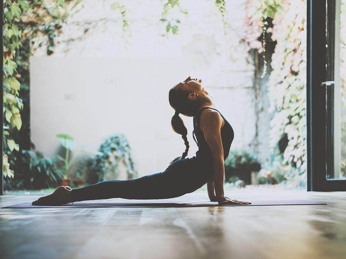 Rainy mood, woman doing yoga stretch