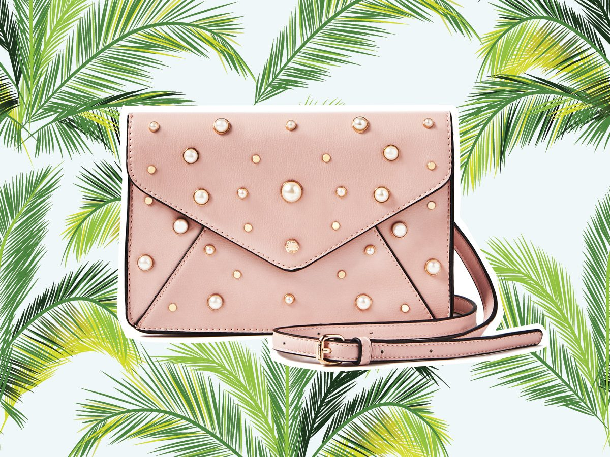 Pink clutch with pearl studs for vacation