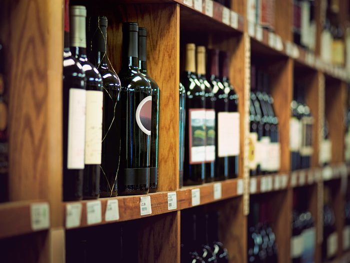 Wine on wooden shelves at store