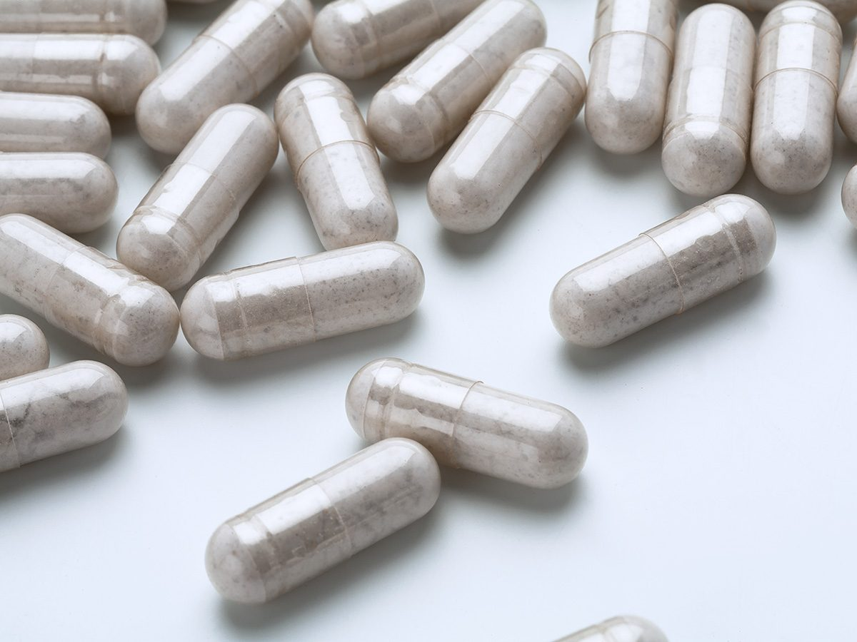 Biotin, glucosamine supplements spilled out on a table