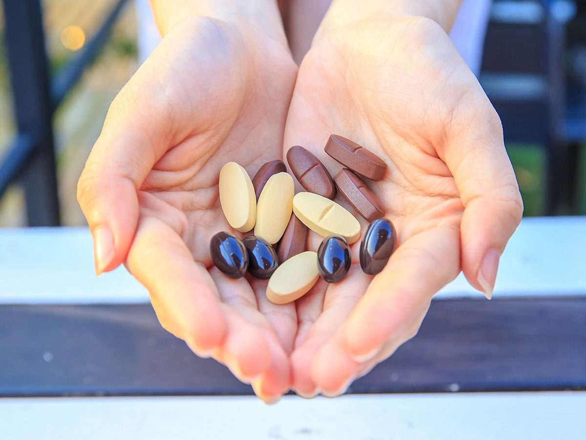 Biotin, woman holds vitamins in her cupped hands