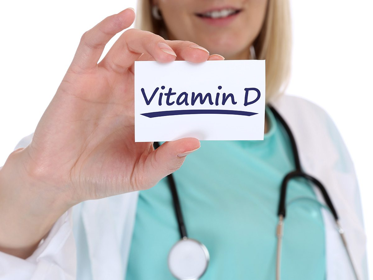 Biotin, doctor holding up a little card that says Vitamin D