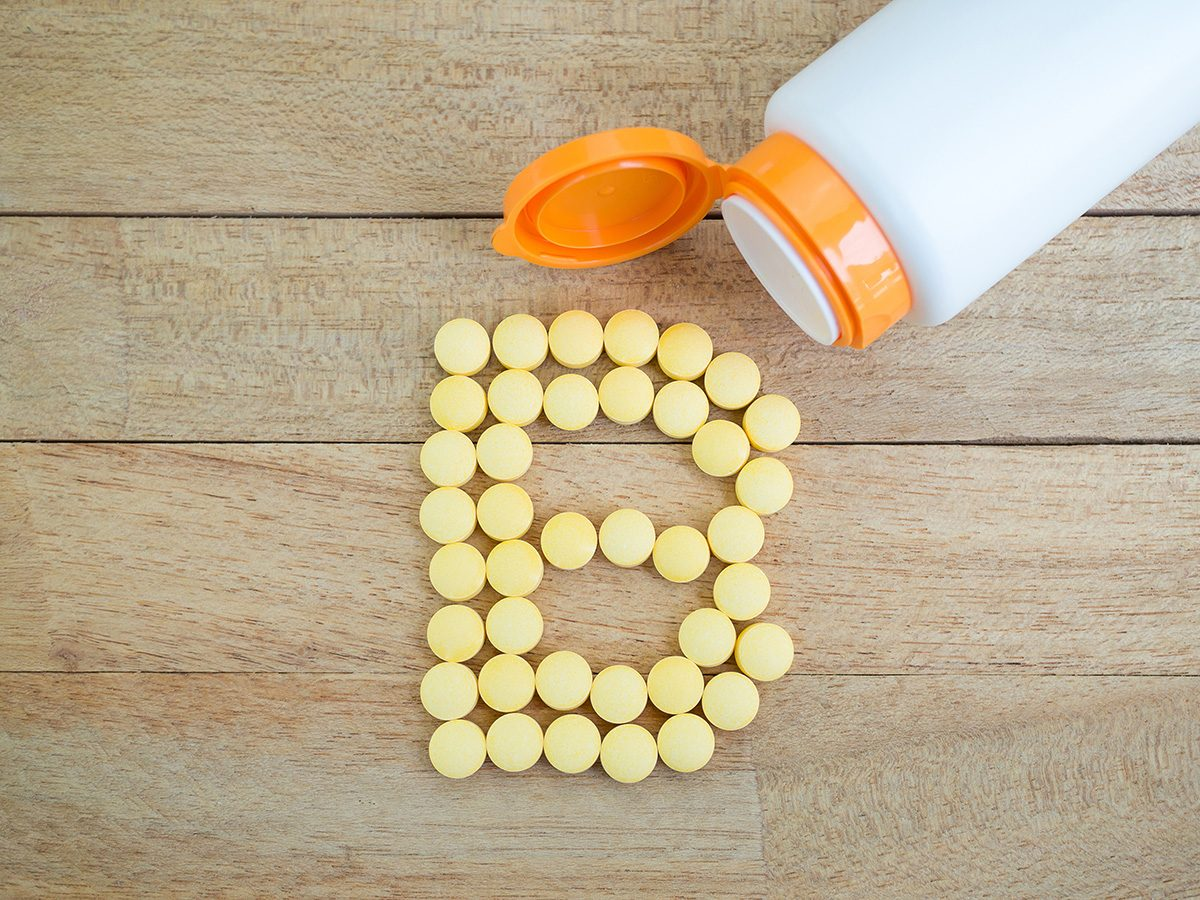 Biotin supplements lying on a table in the shape of a B