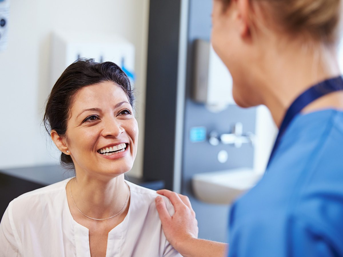 Genetic testing, A happy patient smiles at a nurse who rubs her shoulder
