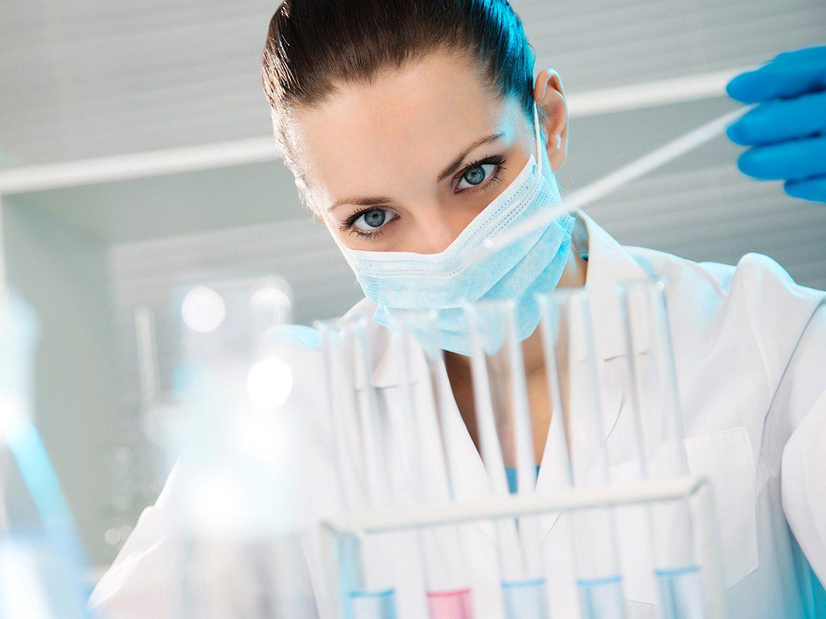 Genetic testing, Scientist checks test tubes