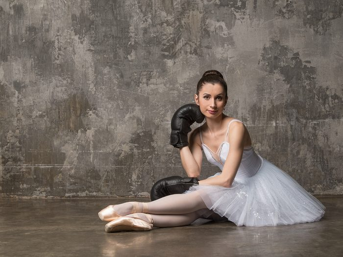 Health trends, a ballerina wearing boxing gloves