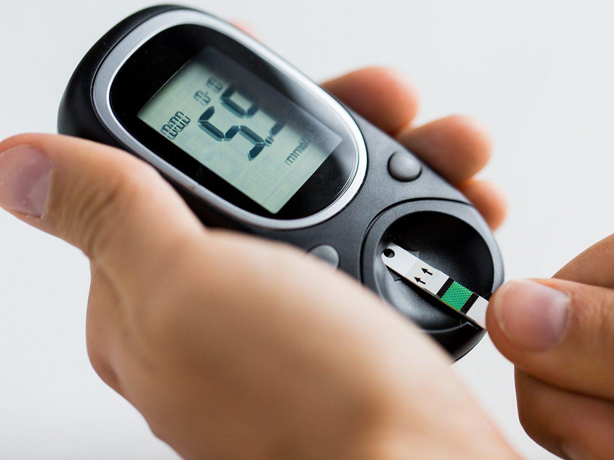 Healthy snacks, woman checks her blood sugar on a small machine